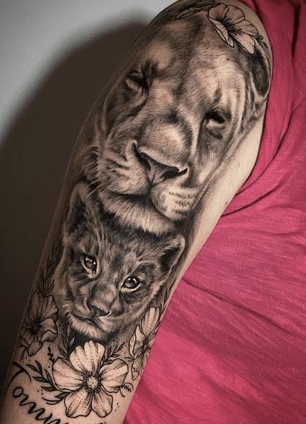 Female lion and cub tattoo sleeve by @bea13_tattooer