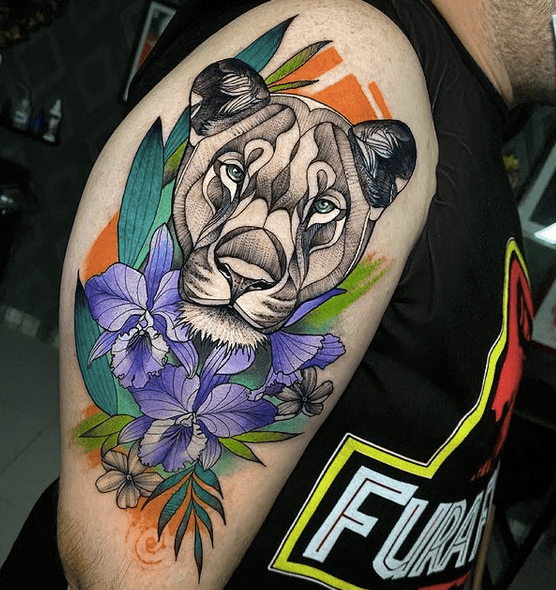 Female lion color tattoo by @misshask1