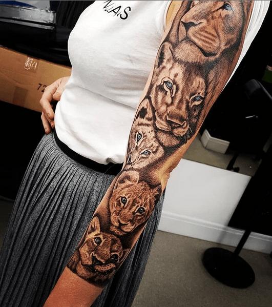 Female lion tattoo sleeve by @megan_bessant_tattoos