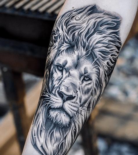 Fierce lion head tattoo by @jannesdegroot.tattoo