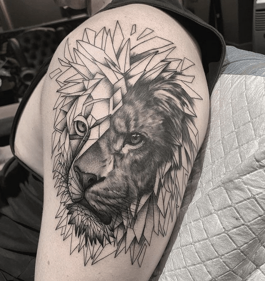 Geometric lion tattoo on the shoulder by @xhris_inked