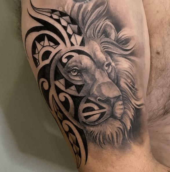 Half realistic half tribal lion tattoo by @hold_fast13