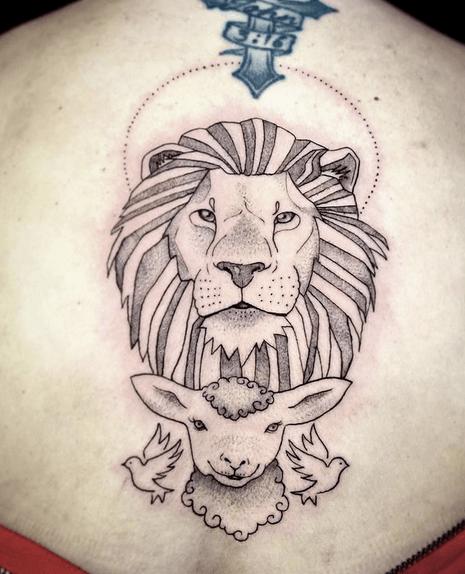 Illustrative lion and lamb tattoo by @the_birdboy_art