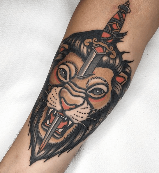 Lion and dagger tattoo by @mr.long_tattooer