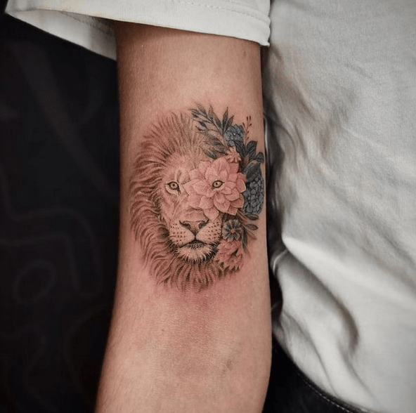 Lion and flowers tattoo in color by @pachamamatattoo_elvis