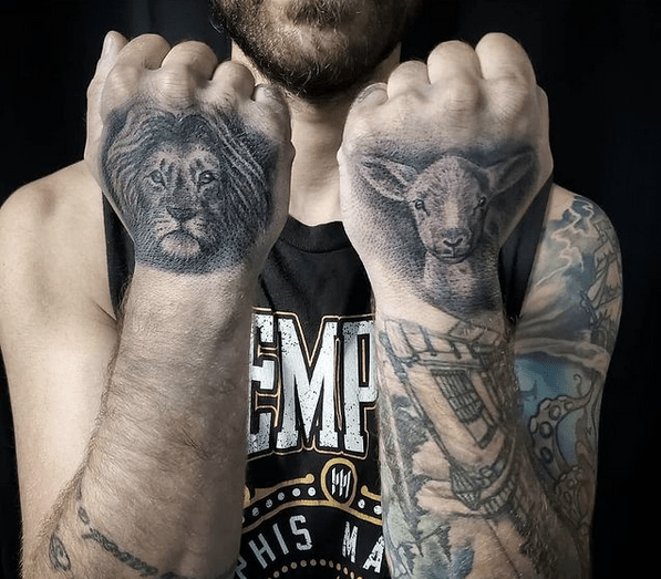 Lion and lamb hand tattoos by @brianmurphyink
