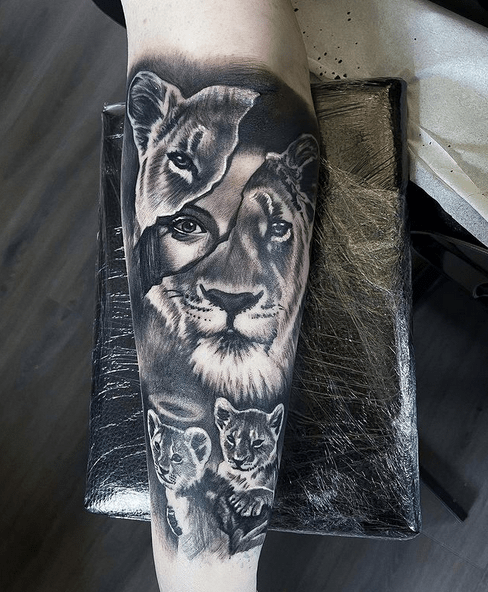 Lion family on forearm tattoo by @house66tattoo