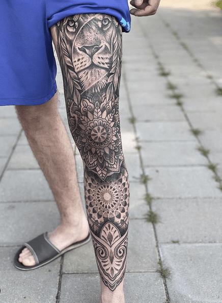 Lion mandala leg tattoo sleeve by @kayecoppoolse