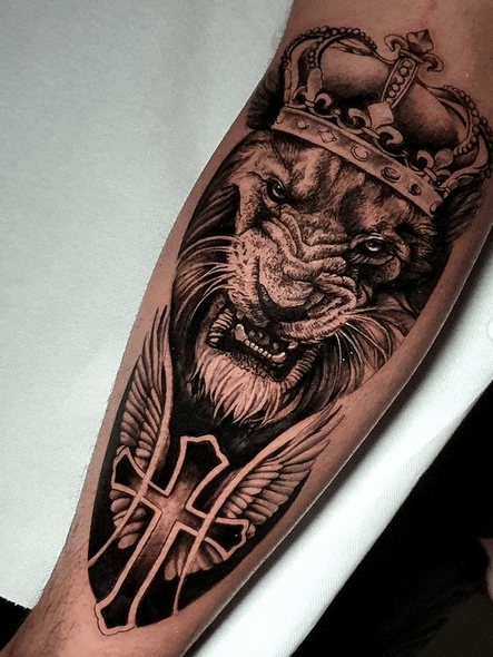 Lion of Judah with a cross tattoo by @phil___tattoo