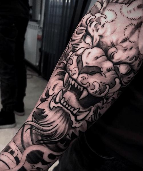 Lion of fu forearm tattoo by @deepdrop_tattoo