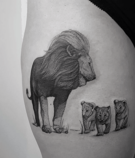 Lion walking with three cubs tattoo by @alejandra.heartist