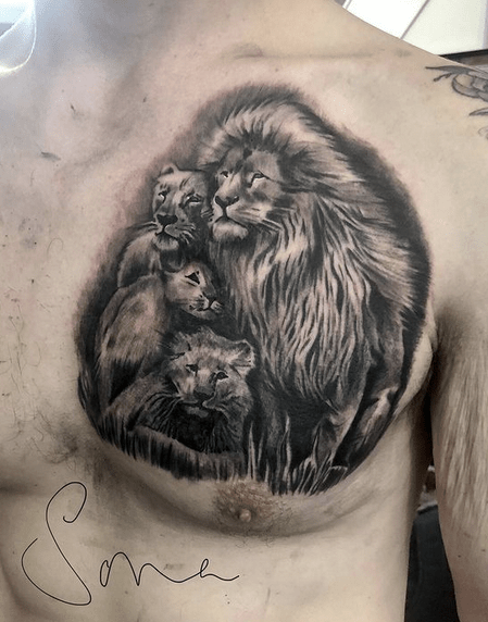 Lion with three cubs on the chest by @sona_tattoos_and_portraits