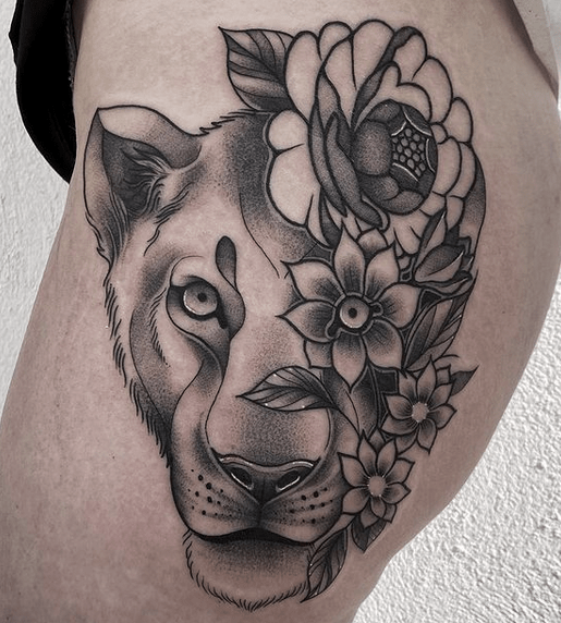 Lioness face with flowers tattoo by @paula.pepper