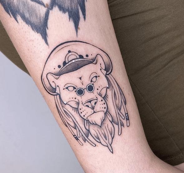 Minimalistic rastafari lion tattoo by @cin.ink