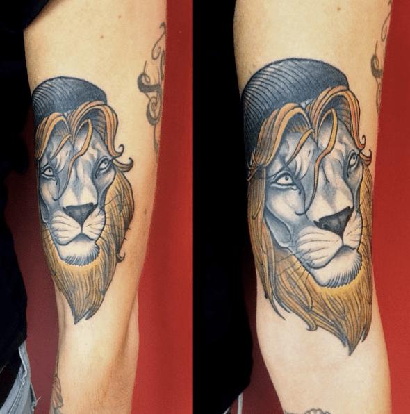Rastafari golden lion tattoo by @fred_ink90