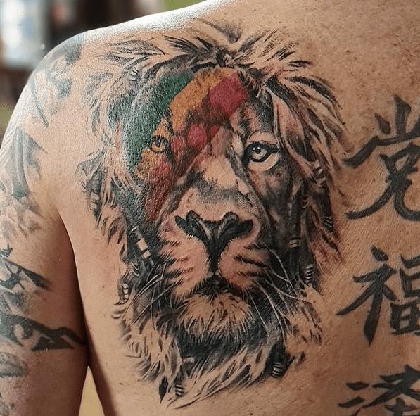 Rastafari lion head tattoo by @sink.tattoo