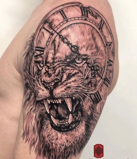 Roaring lion and clock tattoo by @sharfreeman.ink