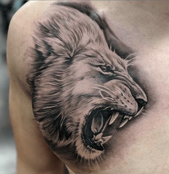 Roaring lion chest tattoo by @inkbyangelikas