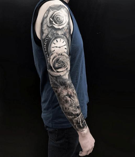 Rose clock lion tattoo sleeve by @jonarton_tattoo
