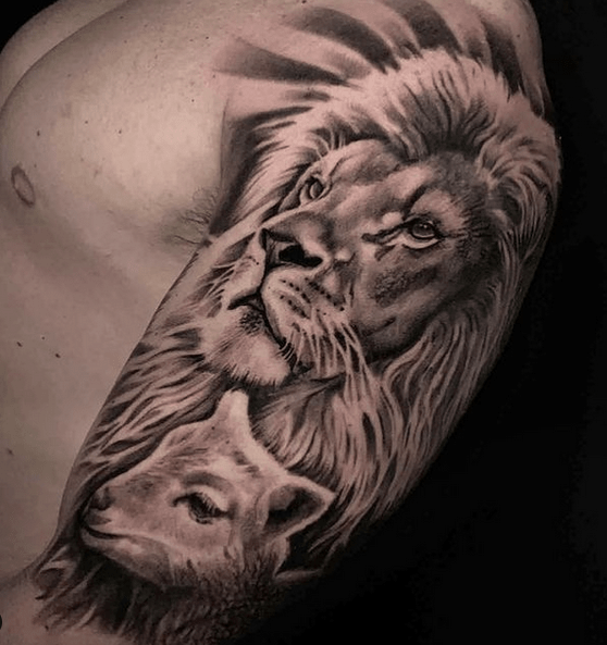 Shoulder tattoo of lion and lamb tattoo by @jayquarles