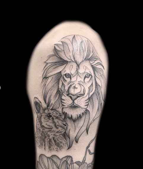 Simple lion and lamb tattoo by @silveransalt