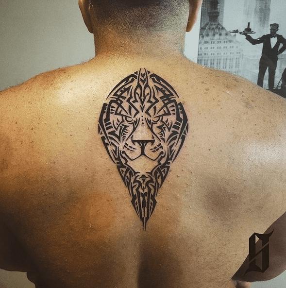 Small back tribal lion tattoo by @kudsink