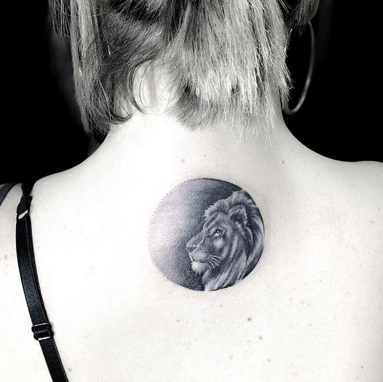 Small black lion tattoo by @linoraimondi