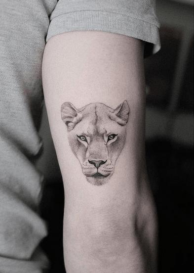 Small female lion head tattoo by @martaszumigaj