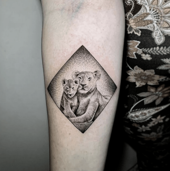 Small lion and cub tattoo by @camilofuentestnt