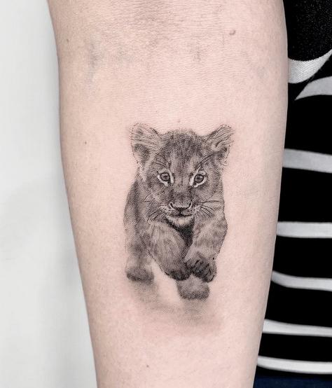 Small lion cub tattoo by @leti.ruggeri