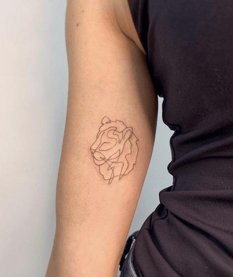 Small lion outline tattoo by @badlystuffedanimal