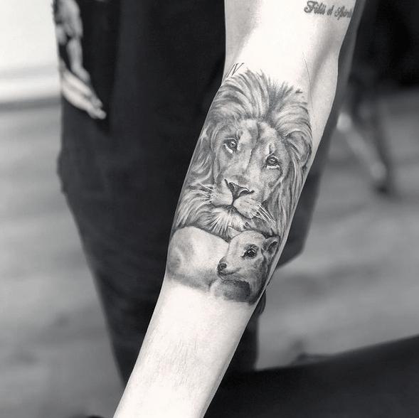 Small realistic lion and lamb tattoo by @wanjaekruger