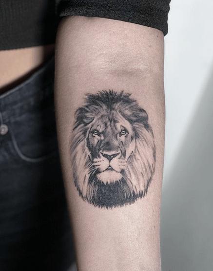 Smalll lion head tattoo by @mattheotats
