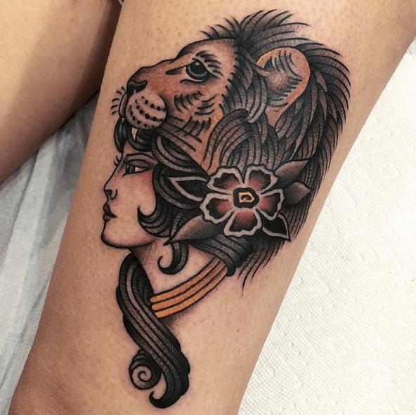 Traditional lion headdress tattoo by @harringtontattoo