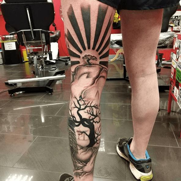 Black Japanese sun tattoo by @mr_lill