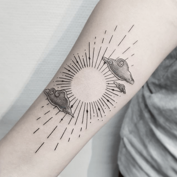 Cloud and sun rays tattoo by @soulofink_dk