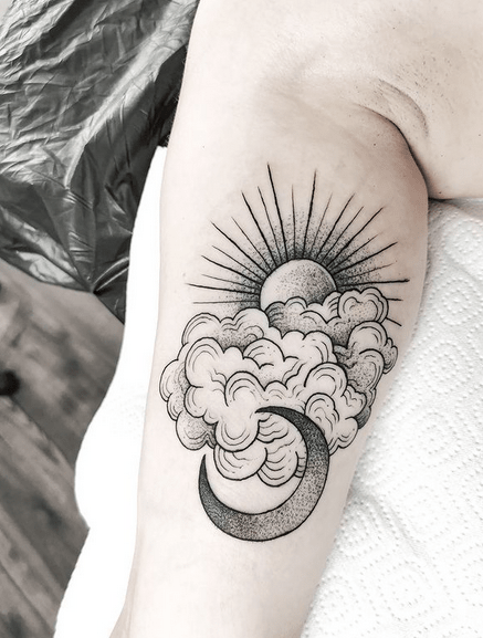 Freehand clouds and sun tattoo by @blackpanda.tattoo