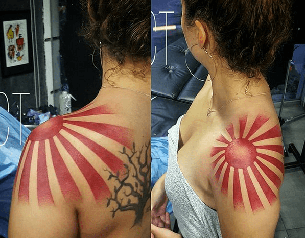 Japanese rising sun tattoo on the shoulder by @ciudad_tattoo_mexico