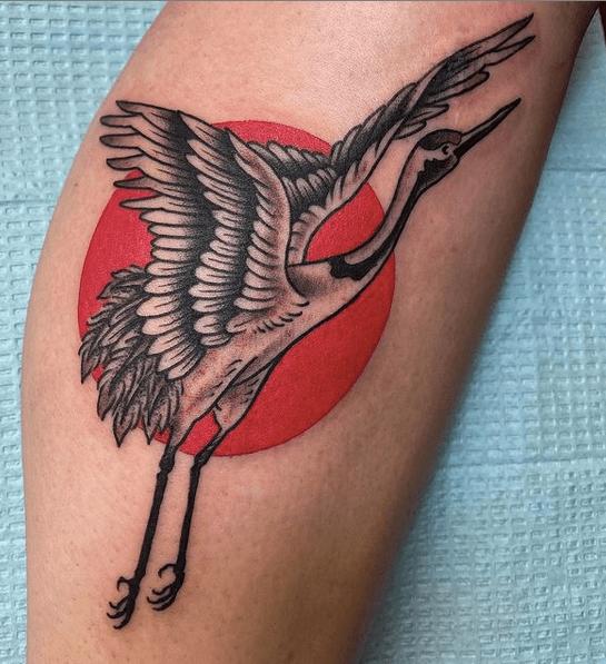 Japanese sun and crane tattoo by @illinoistattooco