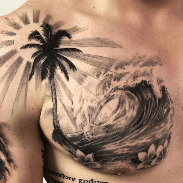 Realistic sun and wave tattoo on chest by @beachparktattoohawaii
