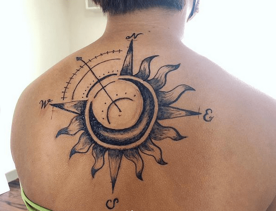 Sun compass tattoo on the back by @mimdrawing