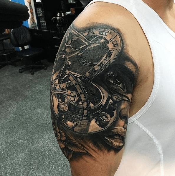 Upper sleeve sun compass tattoo by @gaffydee_tattooartist