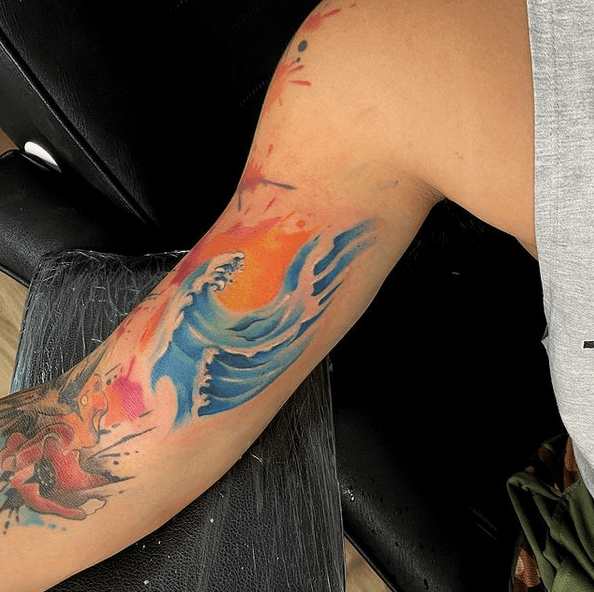 Watercolor sun and wave tattoo by @032_tattoo