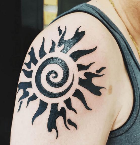 Big shoulder tribal sun tattoo by @jennydella