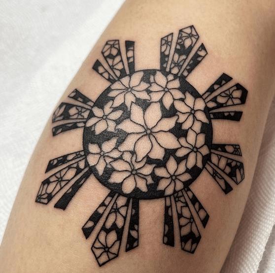 Filipino sun tattoo with hibiscus by @ts_art.tattoo