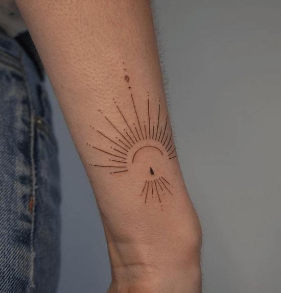 Fine line sun tattoo by @fellina_ink