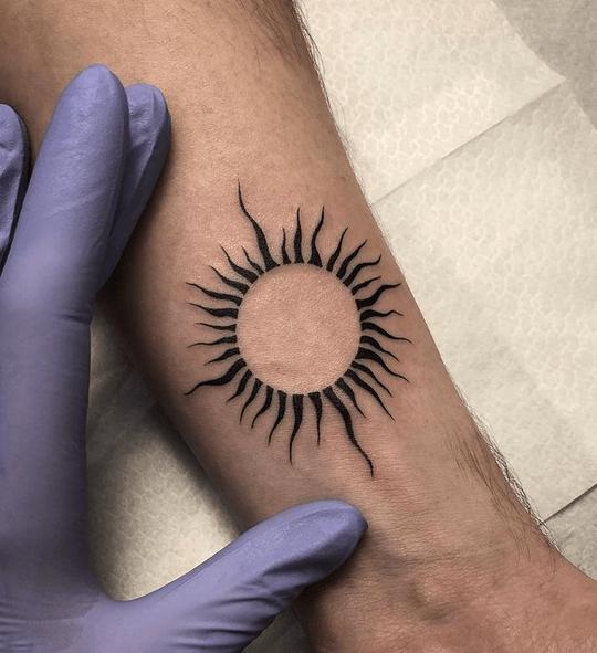 Minimalistic tribal sun tattoo by @lineka.tattoo