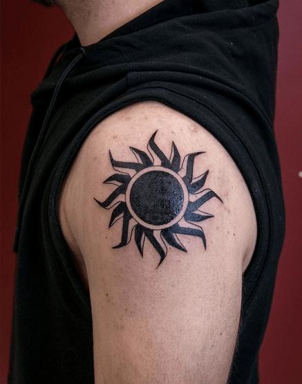 Sharp edge tribal sun tattoo by @dave_lighthouse