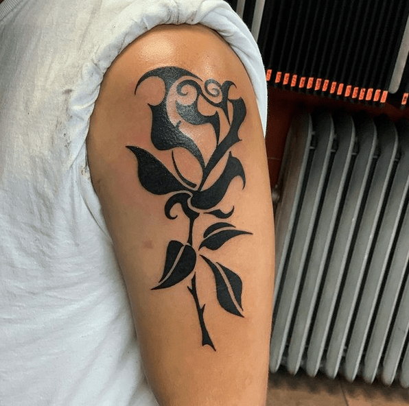 Shoulder tribal rose tattoo by @tattoosfranky