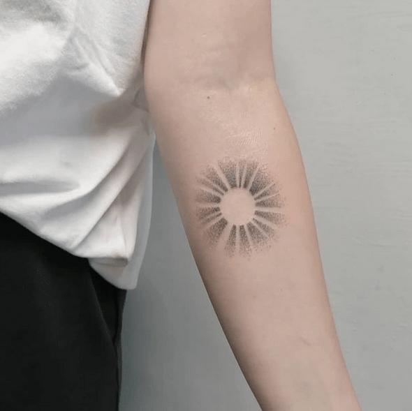 Simple dotwork sun tattoo by @mira.lenkaa